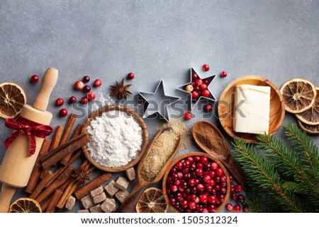 Ingredients for cooking Christmas baking. Flour, sugar, butter, cranberry and spices on kitchen table top view. Bakery background. #1505312324