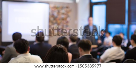 Business presentation being given by executive manager. Corporate seminar with expert speaker presenting to people. Presenter giving speech during lecture. Leadership training coach in workshop.   Royalty-Free Stock Photo #1505385977