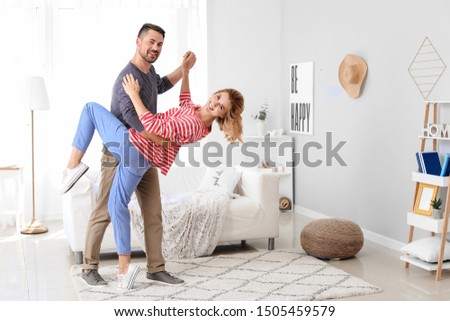 Happy dancing couple at home #1505459579