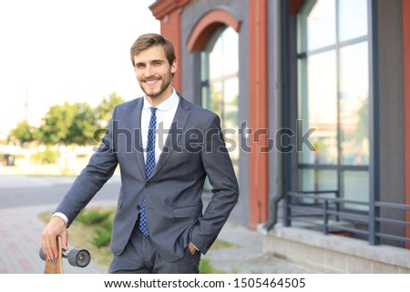 Confident young businessman walking on the street, using longboard. #1505464505