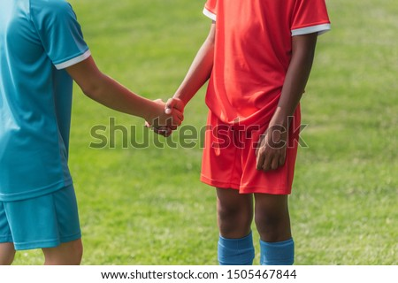 cropped view of multicultural kids shaking hands  #1505467844