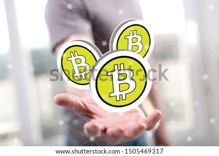 Bitcoin concept above the hand of a man in background #1505469317