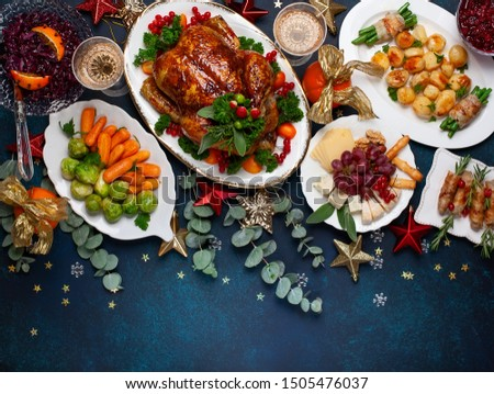 Concept of Christmas or New Year dinner with roasted chicken and various vegetables dishes. Top view. #1505476037