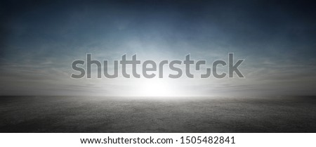 Dramatic Sky with Clouds and Sun Background with Dark Concrete Floor #1505482841