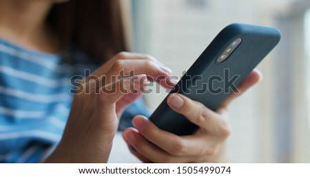 Woman use of mobile phone at home #1505499074