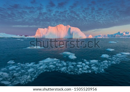 Iceberg at sunset. Nature and landscapes of Greenland. Disko bay. West Greenland. Summer Midnight Sun and icebergs. Big blue ice in icefjord. Affected by climate change and global warming. #1505520956