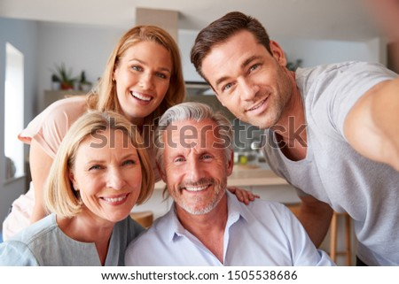 Senior Parents With Adult Offspring Posing For Selfie At Home Royalty-Free Stock Photo #1505538686