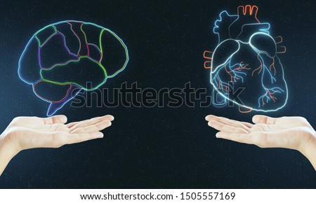 Human verses Artificial Intelligence concept with digital brain and heart hologram layouts above human hands.