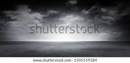 Dramatic Black and White Sky Clouds Empty Concrete Floor Noir Background Scene #1505559284