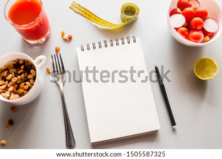 notepad with place for text and vegetables concept healthy eating calorie counting #1505587325