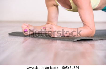 Sports.Beuaty woman at the gym doing stretching exercises and smiling on the floor #1505634824