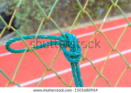 Green rope on the football field #1505680964
