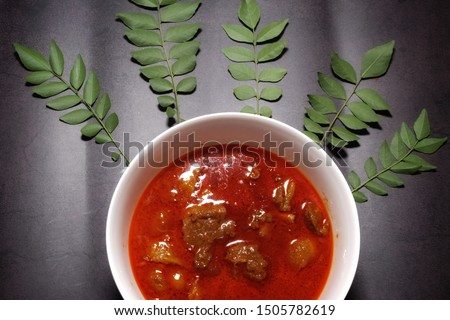 """A picture of """"daging gulai kawah"""" or sweet cauldron curry meat with curry leaves. It is famous in Malaysia especially  Kelantan."""