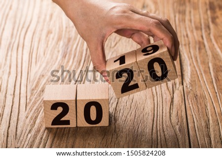 New year 2019 change to 2020 concept hand change wooden cubes. #1505824208