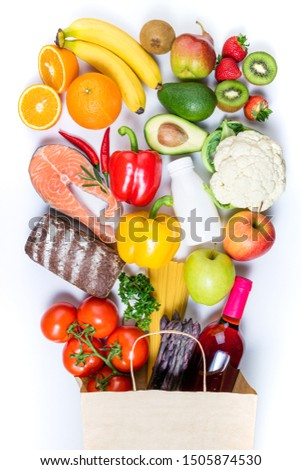 Healthy food background. Healthy food in paper bag fish, pasta, vegetables, fruits and wine on white background. Shopping food supermarket, healthy eating, nutrition plan concept. Top view  #1505874530