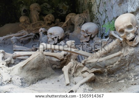 Replica skeletons in the position that the bodies were found after volcanic flow in 79AD Herculaneum Ercolana Campania Italy                                 #1505914367