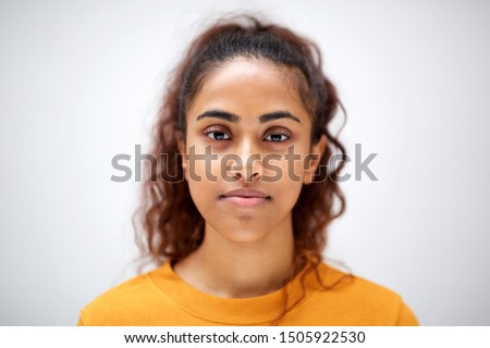 Close up horizontal front portrait of attractive young indian woman with serious expression on face Royalty-Free Stock Photo #1505922530