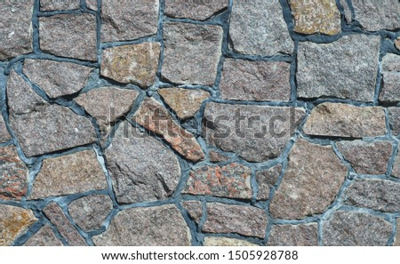 wall of stone blocks of different sizes and different shapes, different colors, cemented together                      #1505928788