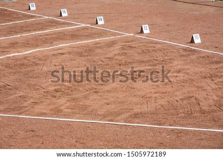 shot put area in stadium with lines and numbers for the width #1505972189