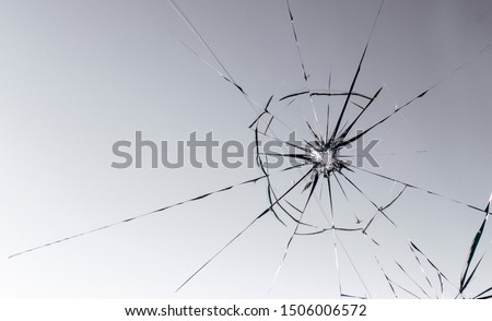 Cracked glass on a white background texture Royalty-Free Stock Photo #1506006572