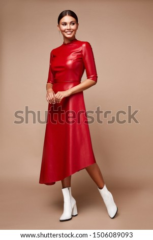 Sexy pretty fashion woman wear lather red dress casual trend clothes collection catalogue  brunette hair party style model pose bright make-up beautiful face dress code office casual accessory shoes. #1506089093