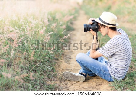 young man taking pictures of nature