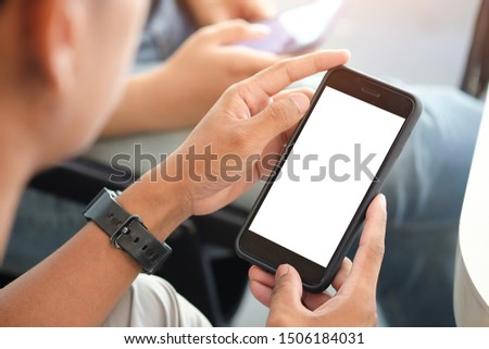 Cropped shot view of man hands holding smart phone with blank copy space screen for your text message or information content, female reading text message on cell telephone during in urban setting.  #1506184031