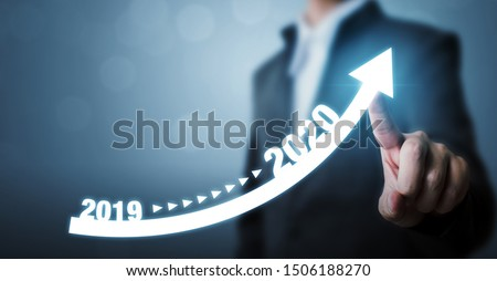 Business development to success and growing growth year 2019 to 2020 concept, Businessman pointing arrow graph corporate future growth plan #1506188270