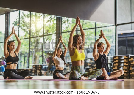 Group of diversity practicing yoga class, healthy or Meditation Exercise,stretching in upward facing dog exercise, wearing sportswear bra and pants, sports and healthcare concept, #1506190697