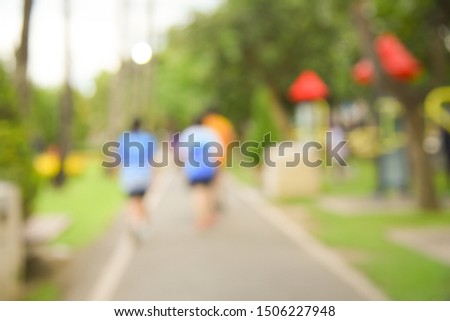 Blurred background of people activities in park with bokeh, spring and summer season #1506227948