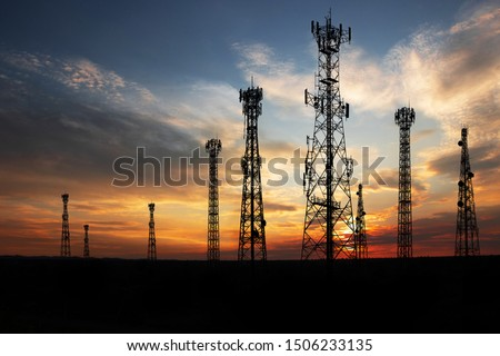Antenna Telephone Network Communication Cable with Sunset Background Royalty-Free Stock Photo #1506233135