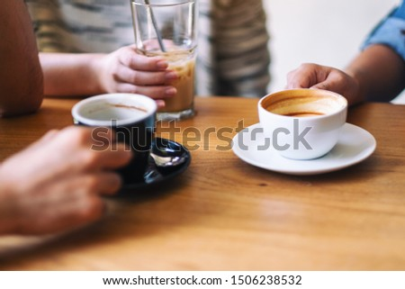 Closeup image of people enjoyed drinking coffee together in cafe