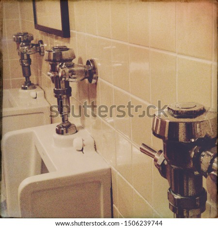 Vintage public men's restroom with sink, urinals and stalls #1506239744
