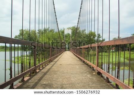 Ancient suspension bridge,Suspension bridge and blue sky. #1506276932