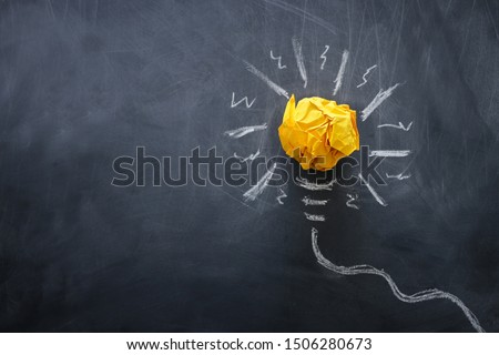 Education concept image. Creative idea and innovation. Crumpled paper as light bulb metaphor over blackboard #1506280673