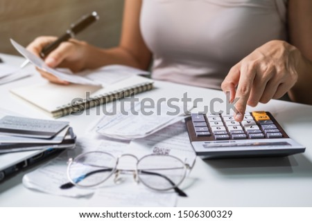 Stressed young woman calculating monthly home expenses, taxes, bank account balance and credit card bills payment, Income is not enough for expenses. #1506300329