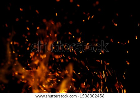 flame of fire with sparks on a black background #1506302456