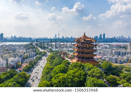 """Aerial view of  Wuhan city .Panoramic skyline and buildings beside yangtze river.4 Chinese letters on tower is """"Nang Xiong Gao Gong"""" means """"amazing heaven"""" Royalty-Free Stock Photo #1506315968"""