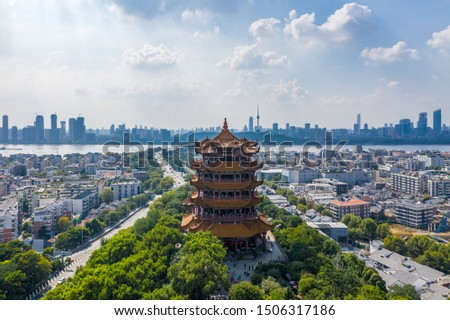 "The yellow crane tower , located on snake hill in Wuhan, is one of the three famous towers south of yangtze river,China.4 Chinese letters on tower is ""Nang Xiong Gao Gong"" means ""amazing heaven"" #1506317186"