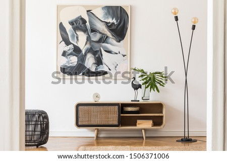 Stylish scandinavian living room interior with modern wooden commode, stylish lamps, plants, rattan basket, sculpture and elegant personal accessories. Mock up paintings on the white wall. Template.  #1506371006