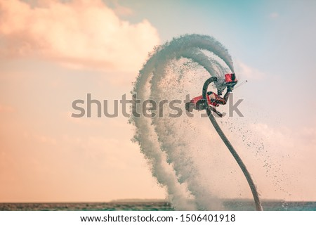 Professional pro fly board rider in tropical sea, water sports concept background. Summer vacation fun outdoor sport and recreation Royalty-Free Stock Photo #1506401918