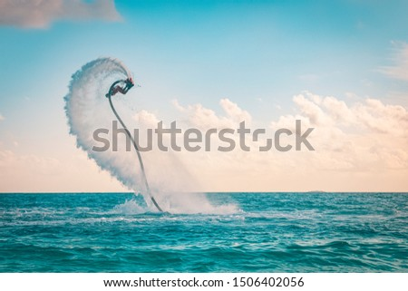 Professional pro fly board rider in tropical sea, water sports concept background. Summer vacation fun outdoor sport and recreation #1506402056