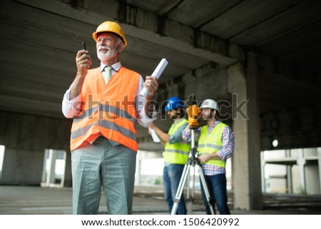 Construction engineers discussion with architects at construction or building site #1506420992