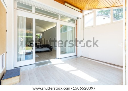 Covered veranda with access to the living room. Nobody inside #1506520097