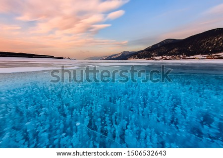 Bubbles of methane gas frozen into clear ice lake baikal, russia #1506532643