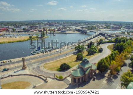 Cityscape with Odra river. Szczecin historical city with architectural layout similar to Paris. Castle of Pomeranian dukes in Szczecin and Basilica of Saint James. The Chrobry Embankment area Royalty-Free Stock Photo #1506547421