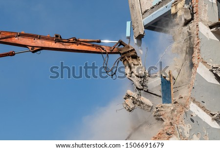 destruction of the building, dismantling the house, excavator Royalty-Free Stock Photo #1506691679