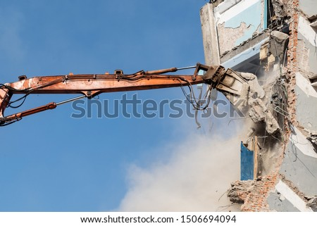 dismantling of the old building, excavator for demolition of the house #1506694094