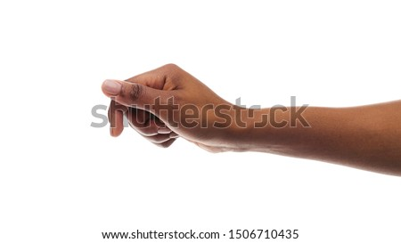 African american woman holding something in fist, ready to share, isolated on white background. Panorana with copy space #1506710435