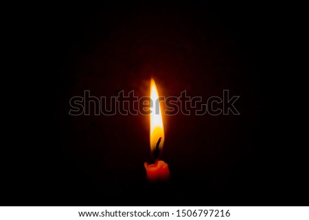 Closeup burning candle in the dark with a dark background. Dark key photo. #1506797216